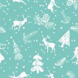 I cervi di Natale attillano il fondo senza cuciture del blu del modello Fotografia Stock Libera da Diritti