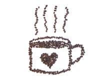 I chicchi di caffè fa una tazza di caffè con cuore Immagini Stock