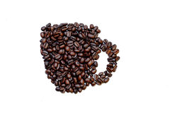 I chicchi di caffè hanno modellato in una tazza Fotografia Stock