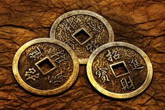 I-ching. Three gold coins used for i-ching prophecy in gold lightning Stock Photography