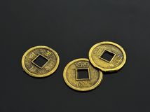 I CHing coins. Traditional chinese coins for I Ching, fortune-telling of the Book of Changes, isolated on neutral dark grey background Royalty Free Stock Photo