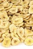 I chip della banana hanno isolato Immagine Stock