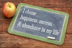 I choose happiness in my life - blackboard sign. I choose happiness, success and abundance in my life - positive affirmation words on a slate blackboard against Stock Photography