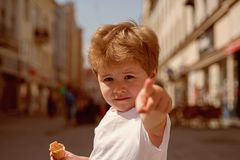 I choose you. Little boy point finger on city street. Small child with stylish haircut. Little child with short blond. Hair. Healthy hair care habits. Hair care royalty free stock photography