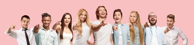 The happy business women and men point you and want you, half length closeup portrait on pink background. stock photos