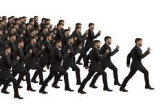 I cloni in marcia seguono il capo Fotografia Stock