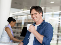 I am confident I can achieve the best results. Confident young businessman with his collegue in the background Stock Photography