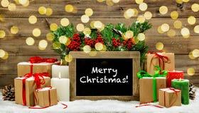 I contenitori di regalo brucianti delle candele della decorazione d'annata di Natale si accende Fotografia Stock Libera da Diritti