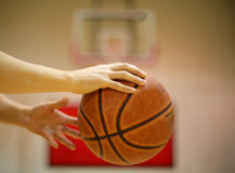I control it_2. A player rolling the basketball with blurred backboard as background Stock Photos