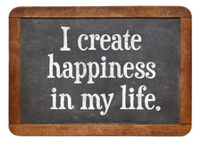 I create happiness in my life. Positive affirmation words on a vintage slate blackboard Stock Photos