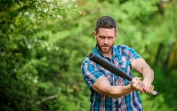 I am a criminal. outdoor sport activity. Hooligan man hits the bat. Bandit gang and conflict. aggression and anger. full. Of energy. unshaven muscular man royalty free stock images