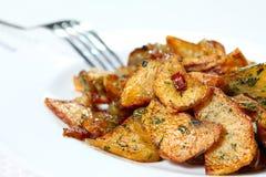 I cunei della patata hanno fritto Fotografia Stock Libera da Diritti