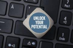 I dadi del cubo sbloccano il vostro potenziale fotografia stock libera da diritti
