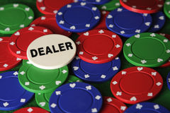 I am the dealer. Assortment of poker chips with dealer button on top Royalty Free Stock Image