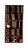 I desideri di festa in scritto tipografico digitano dentro un vecchio legno Fotografia Stock