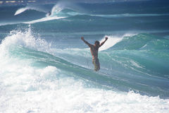 I Did It!. A surfer giving the sign of victory in winter waves off Maui, Hawaii Royalty Free Stock Photography