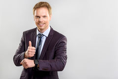 I did everything on time. Everything is alright, a happy manager in suit showing thumb up on white background with copy space Royalty Free Stock Photo