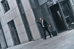 I did it!. Full length of young man in full suit gesturing and shouting while walking outdoors stock photos
