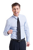 I did it!. Handsome young man in shirt and tie looking at camera and gesturing while standing isolated on white Stock Photo