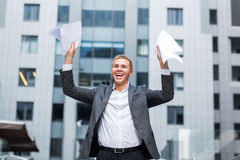 I did it happy young businessman in shirt and tie holding paper and keeping arms raised Royalty Free Stock Image