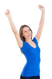 I did it!. Happy young smiling woman keeping arms raised while standing isolated on white Stock Photo