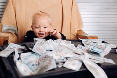 I did it. Startup business costs. Small child do business accounting in startup company. Boy child with money case. Little boy count money in cash. Little royalty free stock image