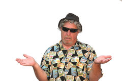I Didn't Do It!. Older gray haired man with hat and shades with body posture that says it's not his fault or why are you looking at me Stock Photo