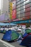 I dimostranti di democrazia di Hong Kong stanno combattendo fuori il loro dirigente principale Immagini Stock Libere da Diritti