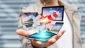 I dispositivi di collegamento di tecnologia dell'uomo d'affari ed il razzo startup 3D rendono Immagini Stock Libere da Diritti