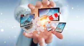 I dispositivi di collegamento di tecnologia dell'uomo d'affari ed il razzo startup 3D rendono Fotografia Stock Libera da Diritti
