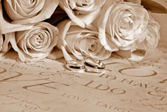 Sepia roses and wedding rings Royalty Free Stock Images