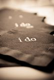 I do napkins. Napkins with the words I do printed on them in sepia Stock Photos