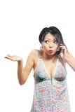 I do not know. Pretty brunette shruging shoulders and talking by telephone Royalty Free Stock Photo