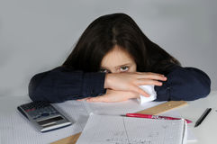 I do not  like mathematics. Frustrated teenager girl sitting at her desk  doing her maths school  homework Stock Photo