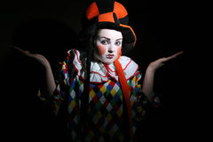 I do not understand. Girl with clown makeup in fancy heat Royalty Free Stock Image