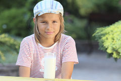 I do not want to drink milk. Portrait of a boy with a glass of milk Stock Photo