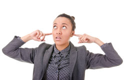 I do not want to hear anything. Portrait of a girl covering the ears with  fingers Royalty Free Stock Images