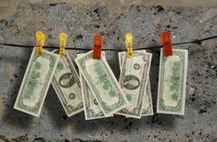 I dollari appendono su una corda Fotografie Stock Libere da Diritti