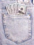 I dollari di fatture in jeans grigi appoggiano la tasca Fotografia Stock