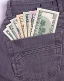 I dollari di fatture in jeans neri appoggiano la tasca Immagine Stock Libera da Diritti