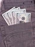 I dollari di fatture in jeans neri appoggiano la tasca Fotografie Stock Libere da Diritti