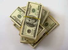 I dollari impilano la gomma bendata Immagini Stock Libere da Diritti