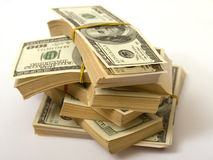 I dollari impilano la gomma bendata Fotografia Stock