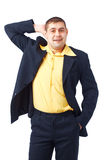 I don't Know. Man in yellow shirt standing and holding his hand on his head Stock Photo