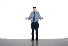 I don't know. A man shrugging against a grungy white wall Royalty Free Stock Photos