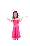 I don't know!. Cute little girl dress in a pink princess costume holding her arm out to the side in an don't know gesture. Isolated on white Royalty Free Stock Images