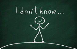 I don't know. On the blackboard draw character and write I don't know Stock Images