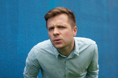 I don`t know. Body language. I don`t know. Headshot of doubtful caucasian male wearing casual blue shirt, looking with indecisive expression on his face, showing Royalty Free Stock Photos