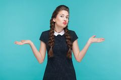 I don`t know. Confused cute girl looking up. Studio shot royalty free stock image