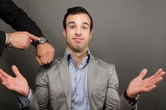 I Don't Know. Image of a young business man making an expression Royalty Free Stock Photography